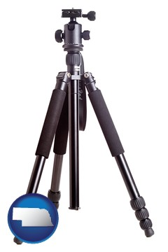 a camera tripod - with Nebraska icon