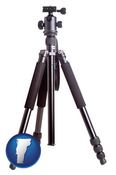 a camera tripod - with Vermont icon
