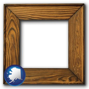 a wooden picture frame - with Alaska icon
