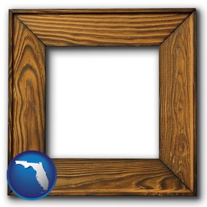 a wooden picture frame - with Florida icon