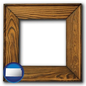 a wooden picture frame - with Kansas icon