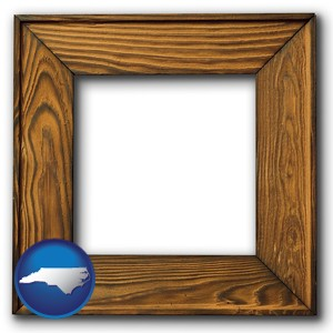 a wooden picture frame - with North Carolina icon