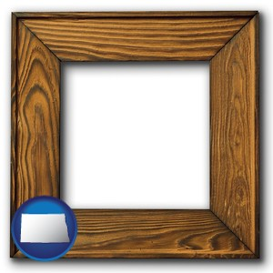 a wooden picture frame - with North Dakota icon