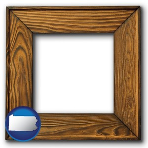 a wooden picture frame - with Pennsylvania icon