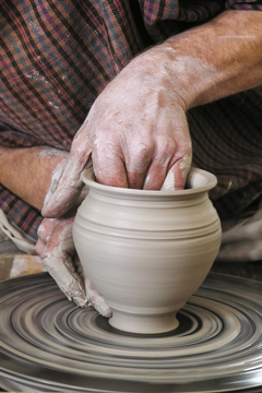 a potter making pottery on a pottery wheel