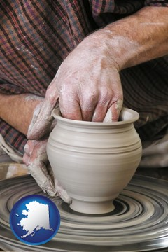 a potter making pottery on a pottery wheel - with Alaska icon