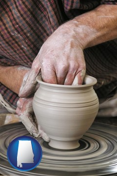 a potter making pottery on a pottery wheel - with Alabama icon