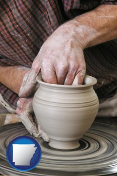 a potter making pottery on a pottery wheel - with Arkansas icon