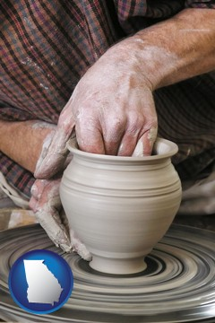 a potter making pottery on a pottery wheel - with Georgia icon