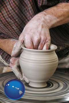 a potter making pottery on a pottery wheel - with Hawaii icon