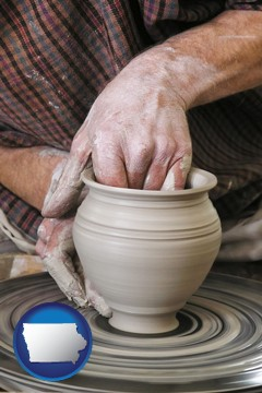 a potter making pottery on a pottery wheel - with Iowa icon