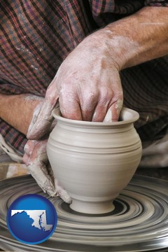 a potter making pottery on a pottery wheel - with Maryland icon