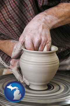 a potter making pottery on a pottery wheel - with Michigan icon