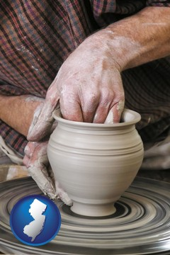 a potter making pottery on a pottery wheel - with New Jersey icon