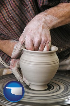 a potter making pottery on a pottery wheel - with Oklahoma icon