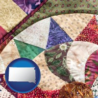 south-dakota map icon and a patchwork quilt