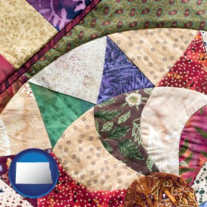 a patchwork quilt - with North Dakota icon