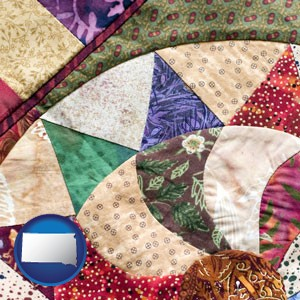a patchwork quilt - with South Dakota icon