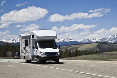 recreational vehicle and snow-capped mountains
