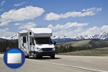 recreational vehicle and snow-capped mountains - with Colorado icon