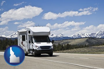recreational vehicle and snow-capped mountains - with Idaho icon