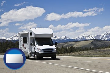 recreational vehicle and snow-capped mountains - with Kansas icon