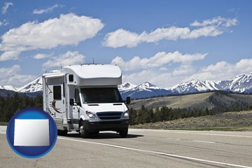 recreational vehicle and snow-capped mountains - with Wyoming icon