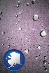 ak map icon and water droplets on a shower door