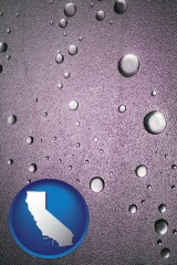 ca map icon and water droplets on a shower door