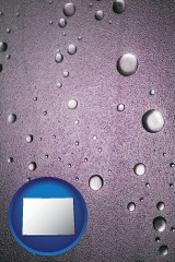 co map icon and water droplets on a shower door