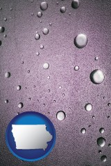 ia map icon and water droplets on a shower door