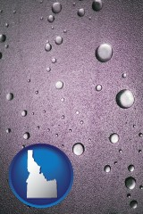 id map icon and water droplets on a shower door