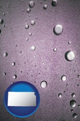 ks map icon and water droplets on a shower door