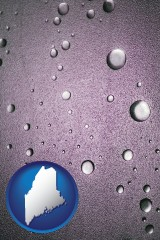 me map icon and water droplets on a shower door