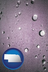 ne map icon and water droplets on a shower door
