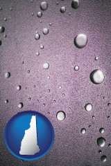 nh map icon and water droplets on a shower door