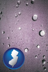 nj map icon and water droplets on a shower door