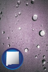 nm map icon and water droplets on a shower door