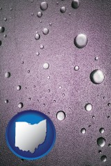 oh map icon and water droplets on a shower door