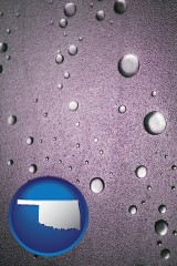 ok map icon and water droplets on a shower door