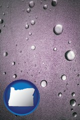 or map icon and water droplets on a shower door