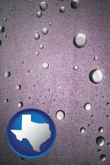 tx map icon and water droplets on a shower door