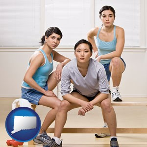 three athletes wearing sportswear - with Connecticut icon