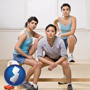 three athletes wearing sportswear - with New Jersey icon
