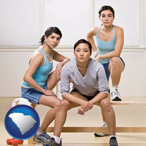 three athletes wearing sportswear - with South Carolina icon
