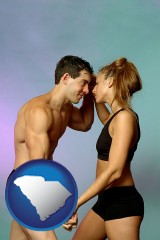 south-carolina a couple wearing black swimsuits