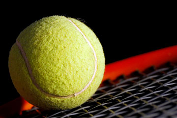 a yellow tennis ball and tennis racket