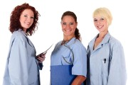 three female doctors wearing hospital uniforms