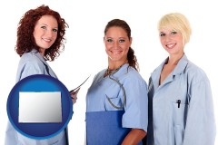 colorado three female doctors wearing hospital uniforms