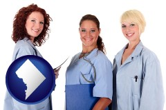 washington-dc three female doctors wearing hospital uniforms
